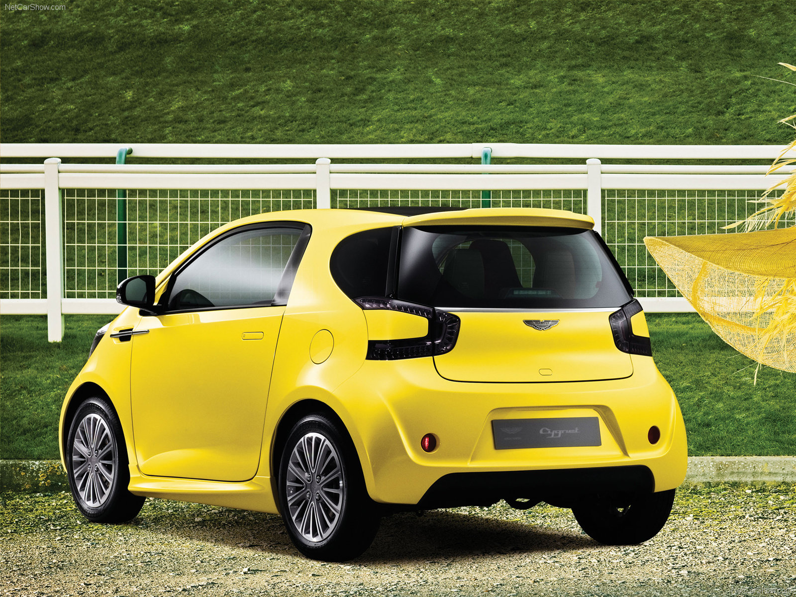 aston martin cygnet yellow